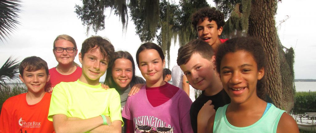 High school campers smiling on the Lake Griffin shore line.